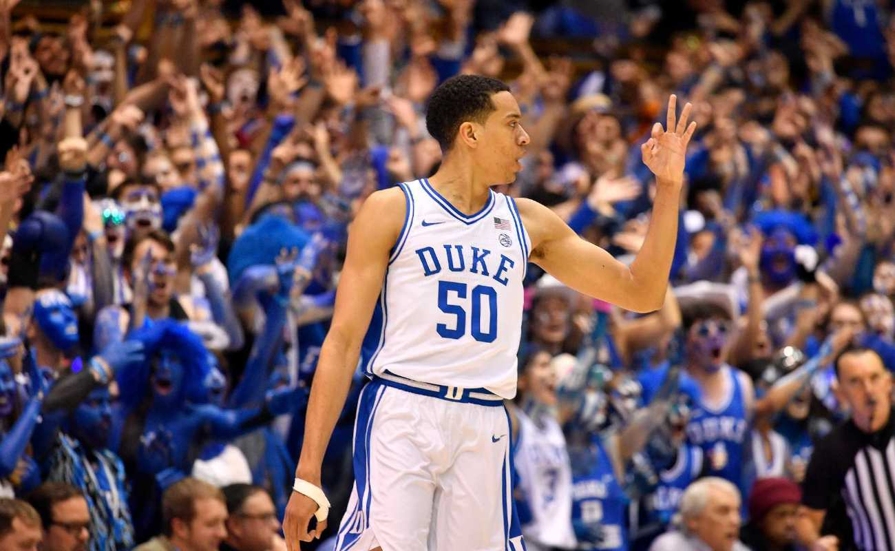 Justin Robinson of Duke Blue Devils reacts after making a three-point basket during basketball game