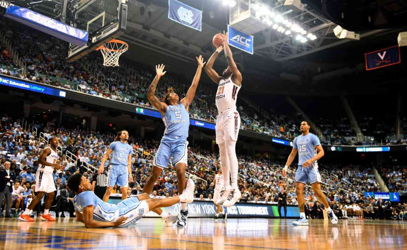 John Ojiako of Virginia Tech Hokies attempts a shot against Armando Bacot of North Carolina Tar Heels
