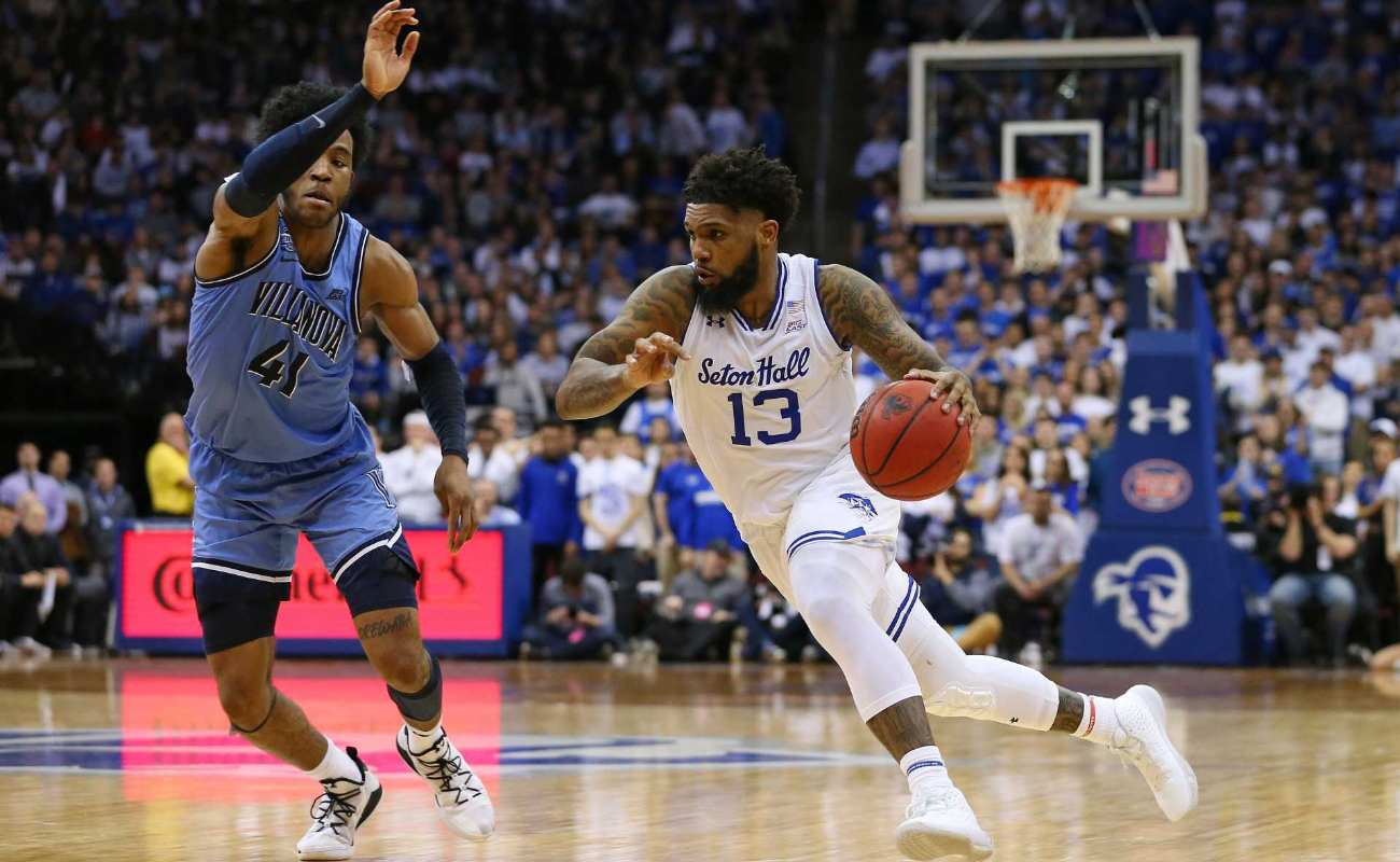Myles Powell of Seton Hall Pirates in action against Saddiq Bey of Villanova Wildcats during college basketball game