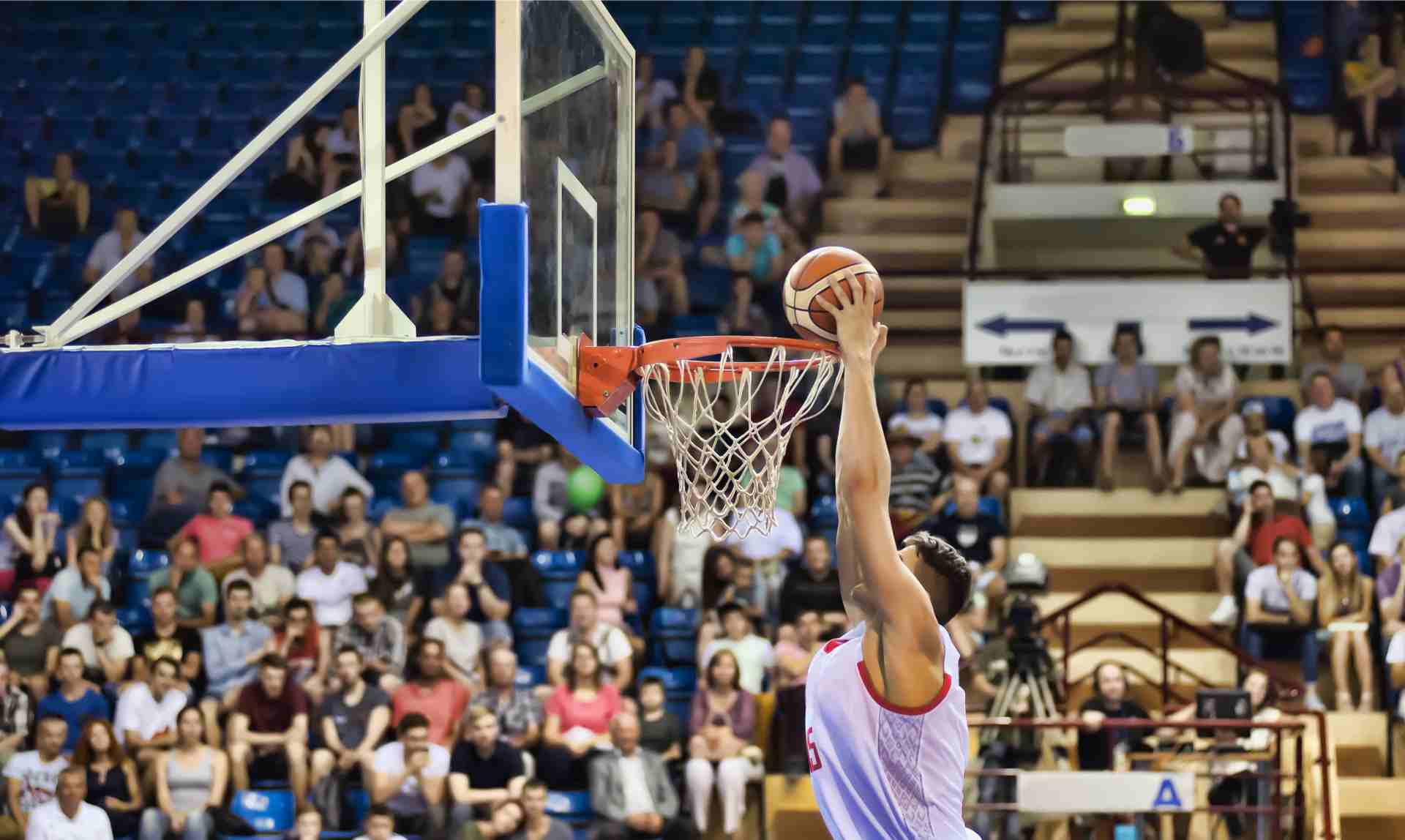 Player throws basketball into the basket