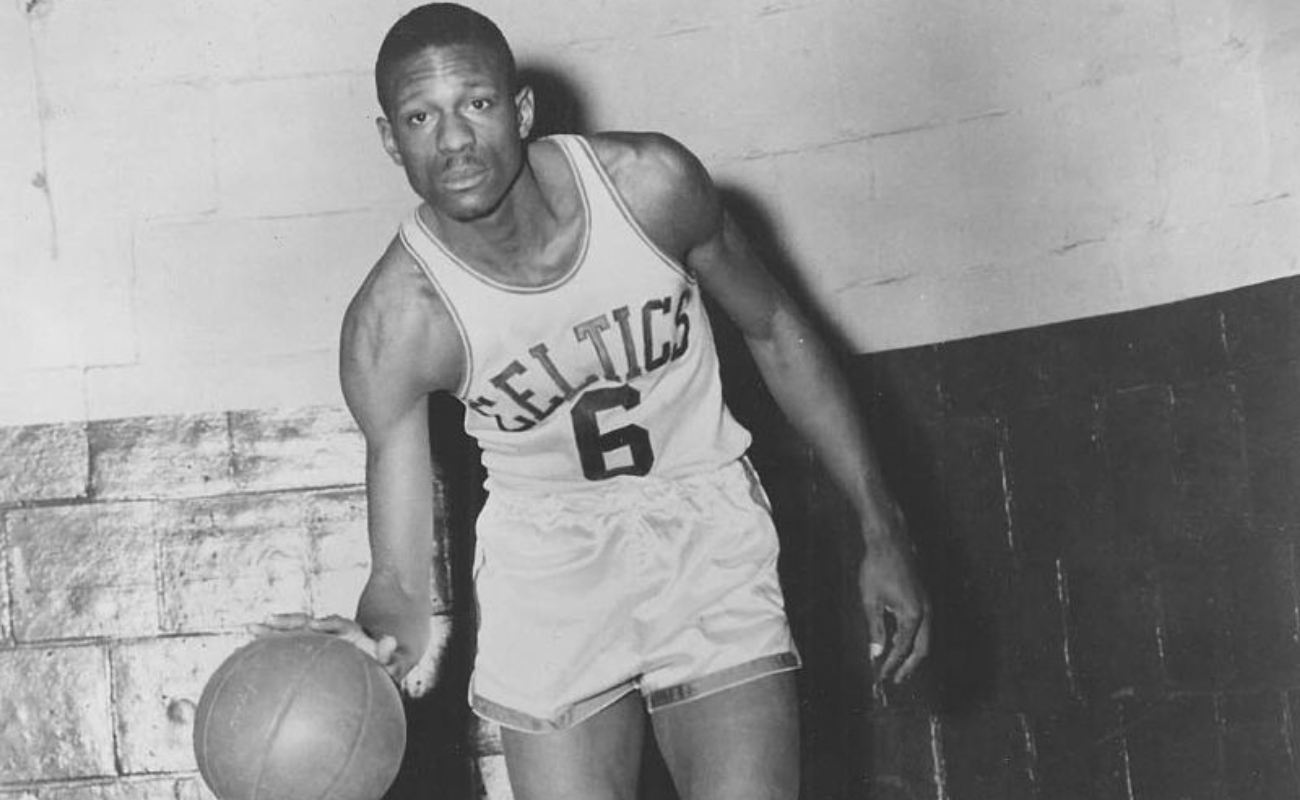 Former Boston Celtics player, Bill Russell dribbling basketball 1960