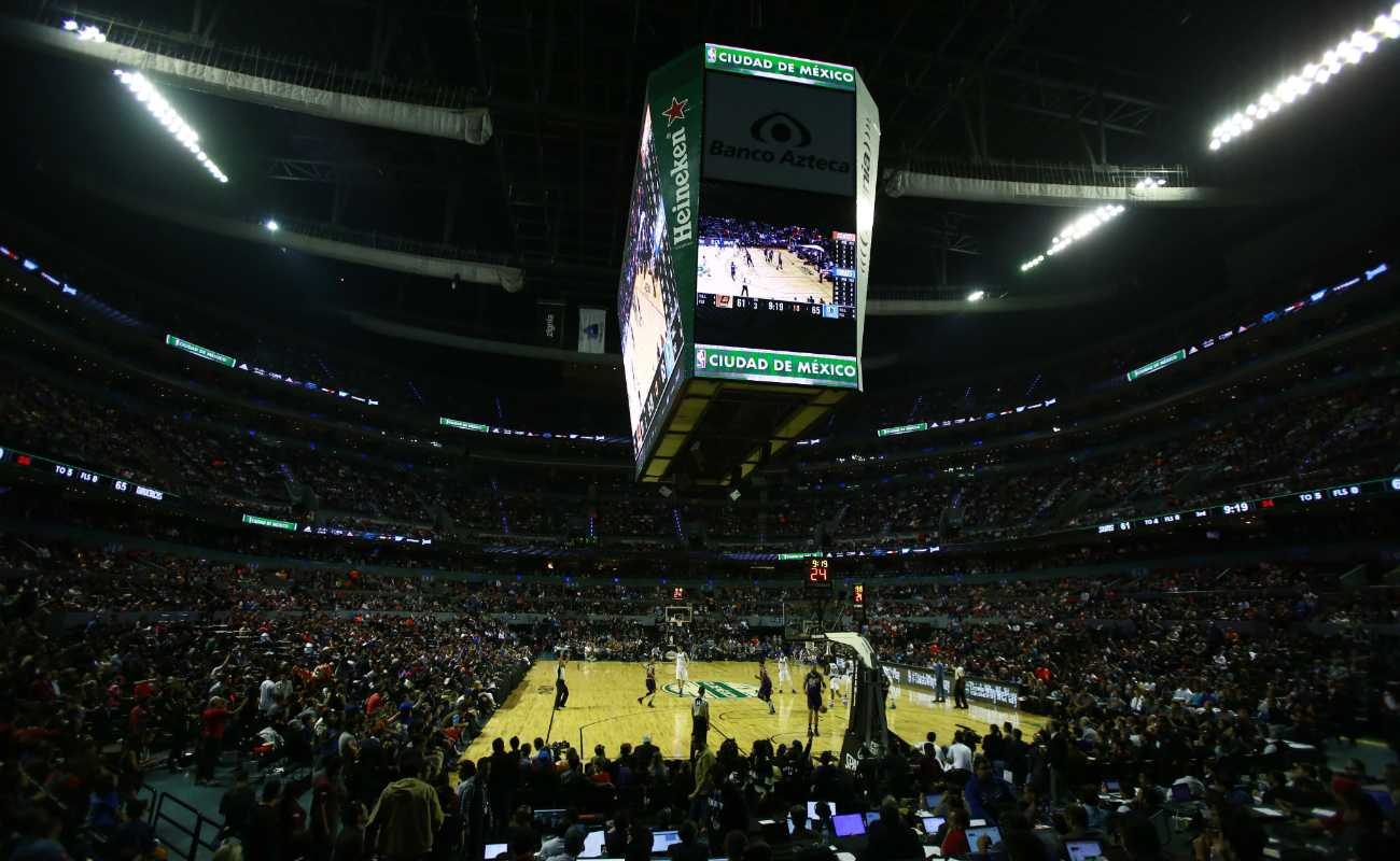 Basketball arena full of fans watching a basketball game