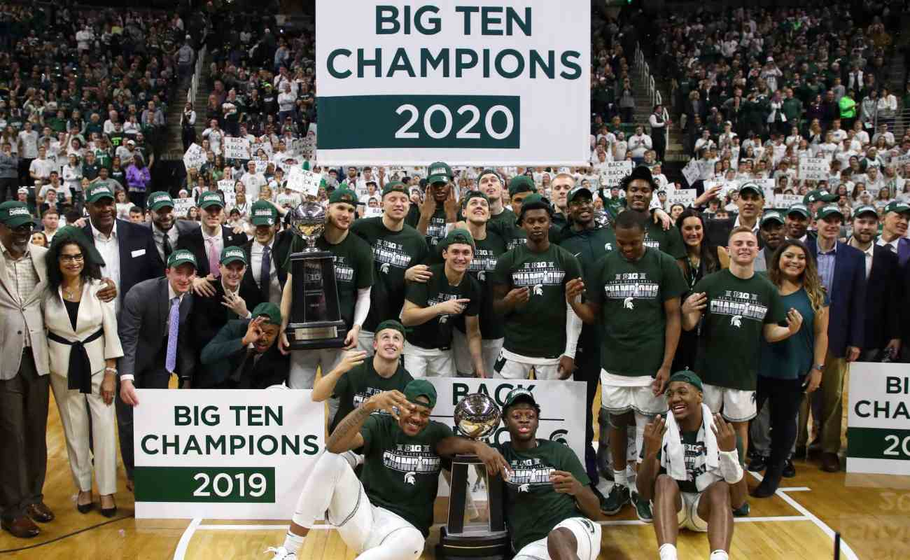 The Michigan State Spartans celebrate their share of a Big Ten Championship March 2020