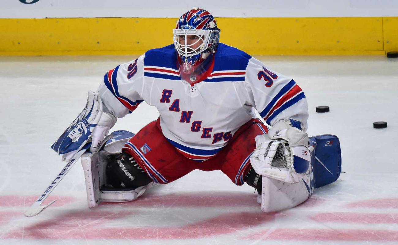 Goaltender Henrik Lundqvist #30 of the New York Rangers stretches during the warm-up prior to the game against the Montreal Canadiens at the Bell Centre
