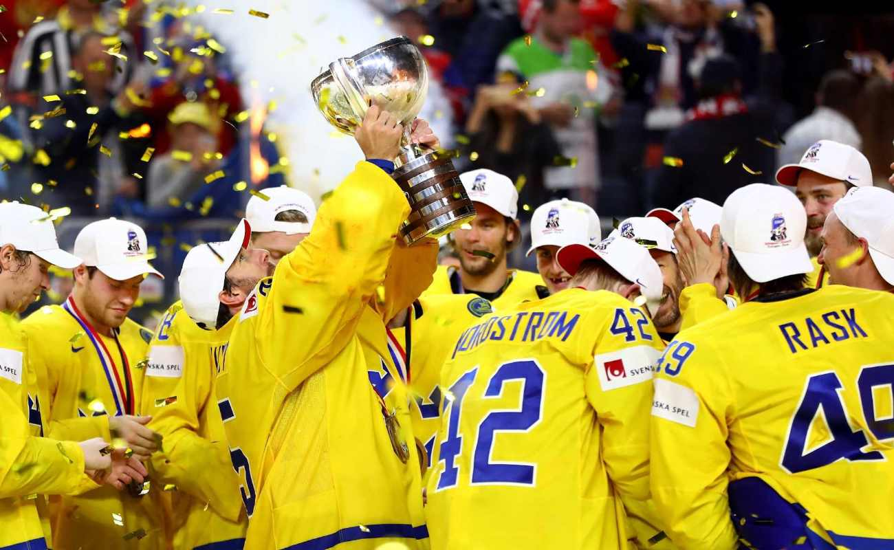 Henrik Lundqvist, goaltender of Sweden lifts the trophy after the 2017 IIHF Ice Hockey World Championship Gold Medal