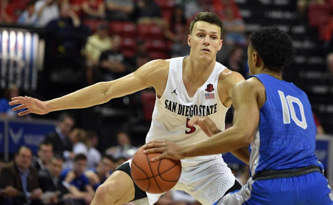 Yanni Wetzell of San Diego State Aztecs defends against A.J. Walker of Air Force Falcons