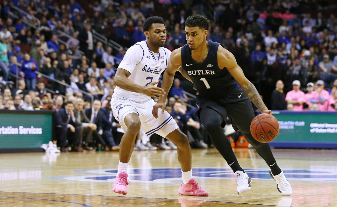 Jordan Tucker #1 of the Butler Bulldogs in action against Anthony Nelson #2 of the Seton Hall Pirates