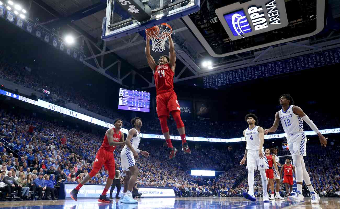 Dwayne Sutton #24 of the Louisville Cardinals shoots the ball against the Kentucky Wildcats at Rupp Arena