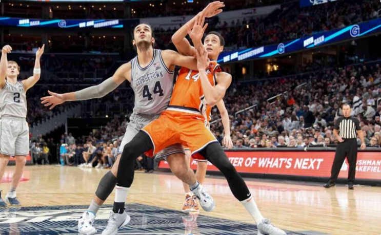 Omer Yurtseven of Georgetown Hoyas fights for position with Jesse Edwards of Syracuse Orange during a college basketball game