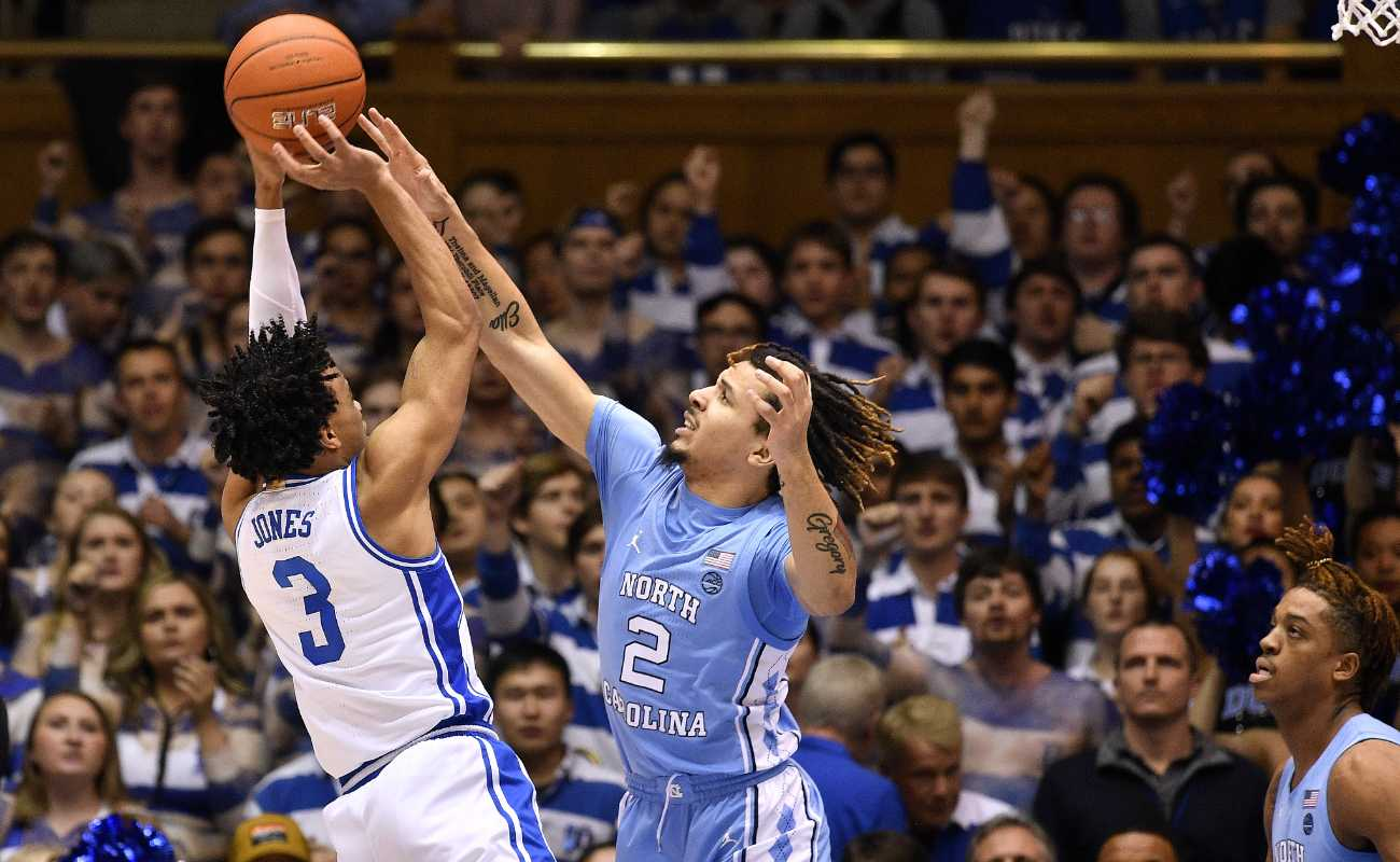 Cole Anthony of North Carolina Tar Heels challenges a shot by Tre Jones of Duke Blue Devils during game at Cameron Indoor Stadium