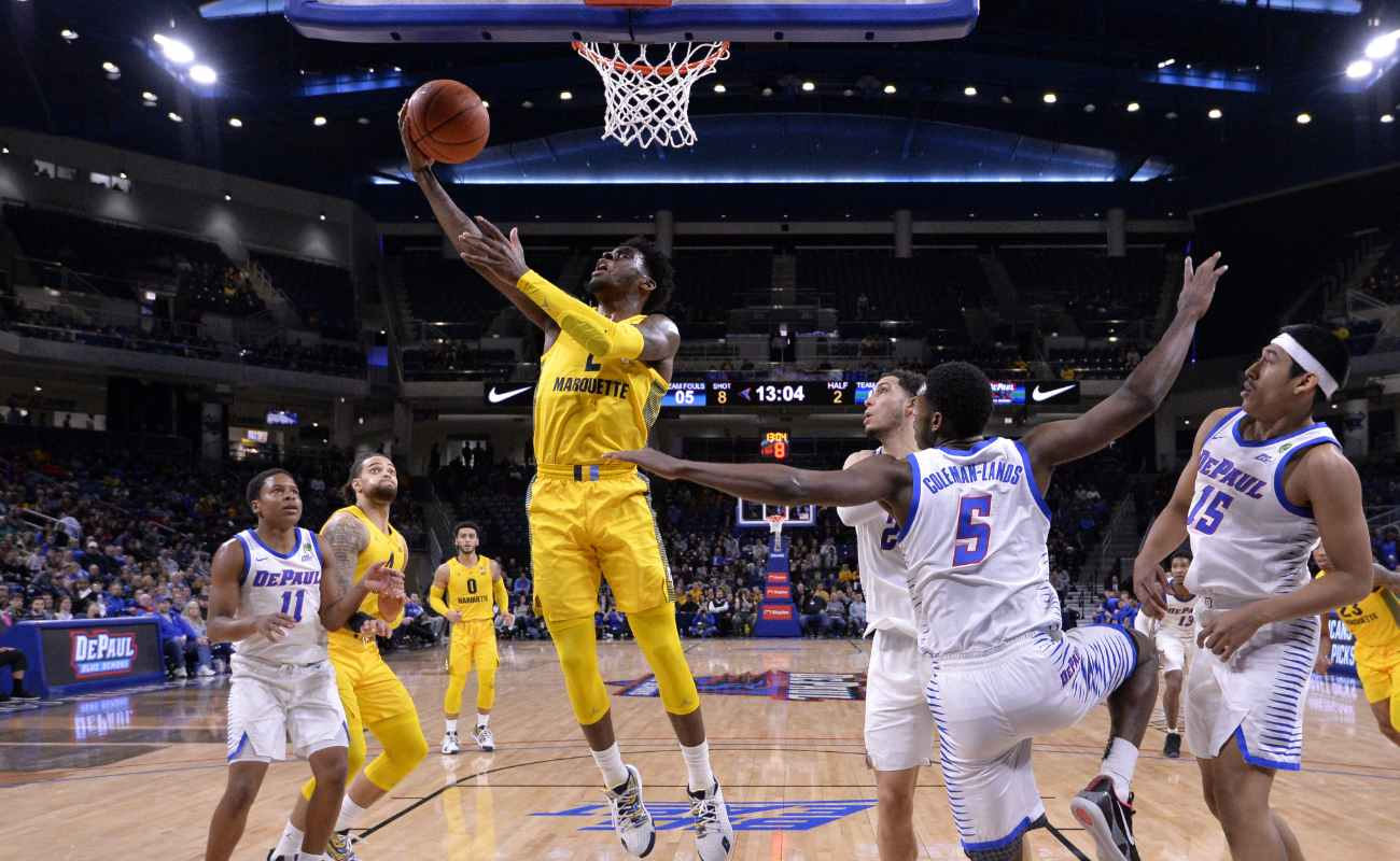Sacar Anim #2 of the Marquette Golden Eagles shoots i against the DePaul Blue Demons