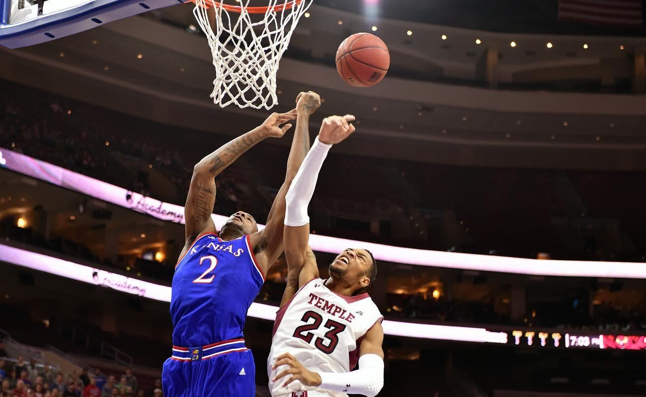 Temple center Devontae Watson and Kansas Jayhawks forward Cliff Alexander battle for a rebound