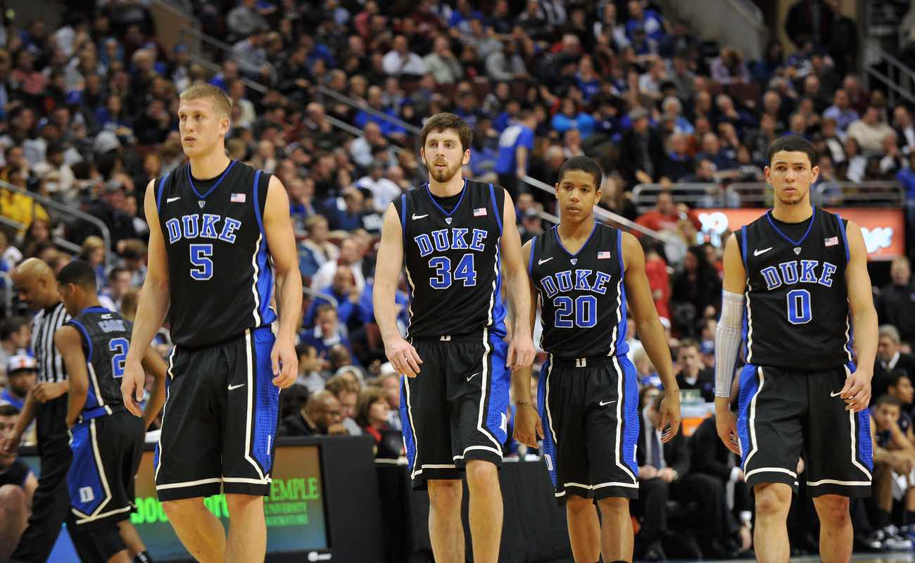 The Duke men's basketball teams heads onto the court following a timeout