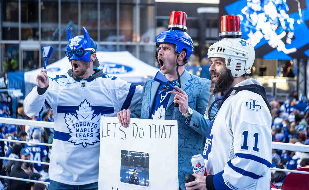 Fans Pose With a Sign at the Scotiabank Arena Viewing Party