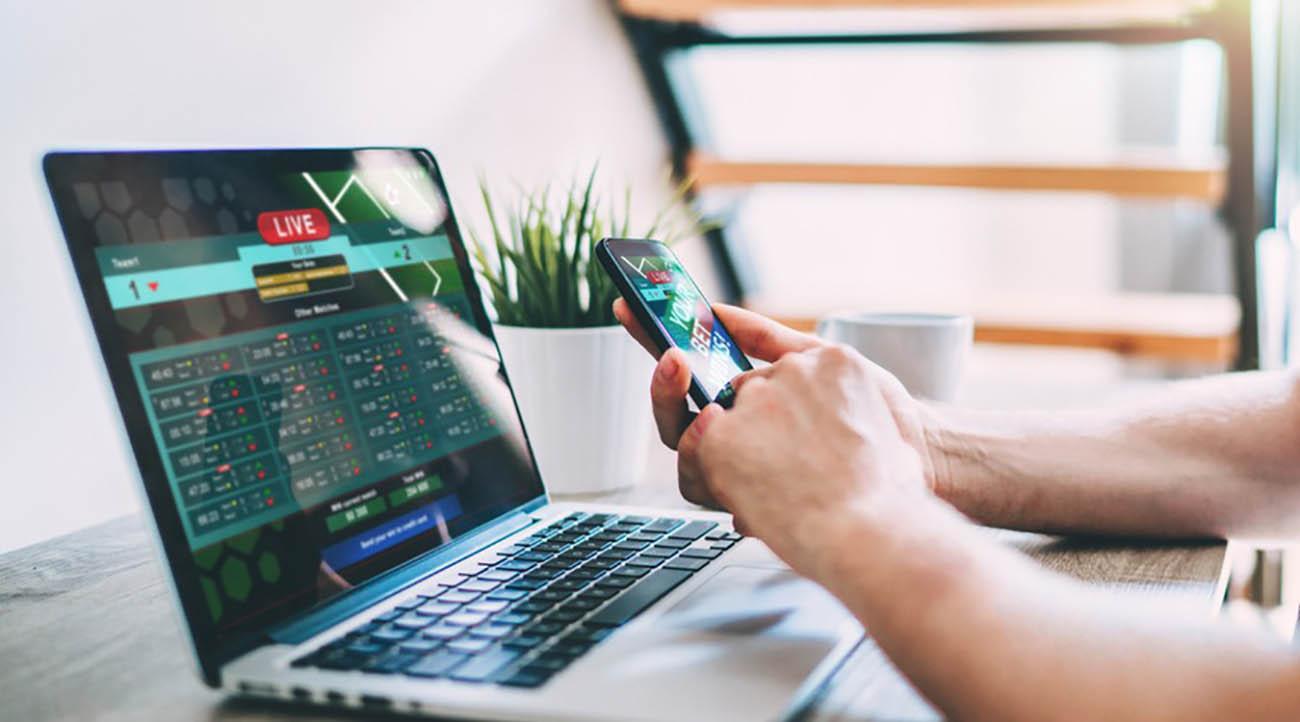 Men hands betting online using smartphone