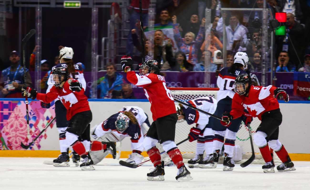 Canadian Ice hockey team celebrating gold medals