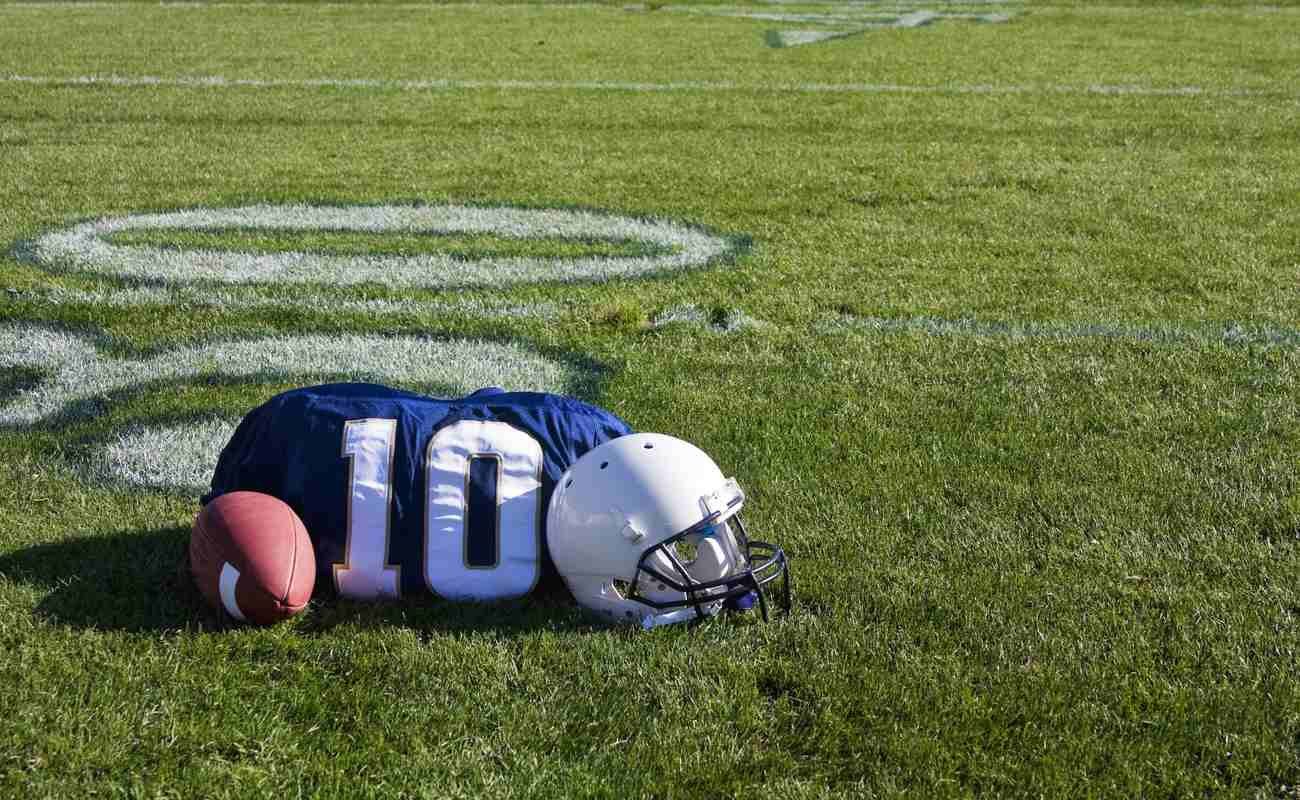 Football, jersey and helmet on the floor