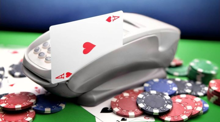 Playing ace card swiped on speedpoint surrounded by chips