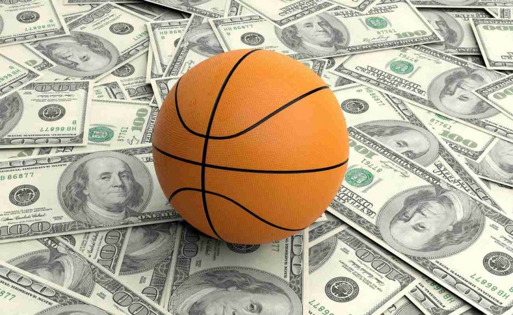 Basketball on top of banknotes.