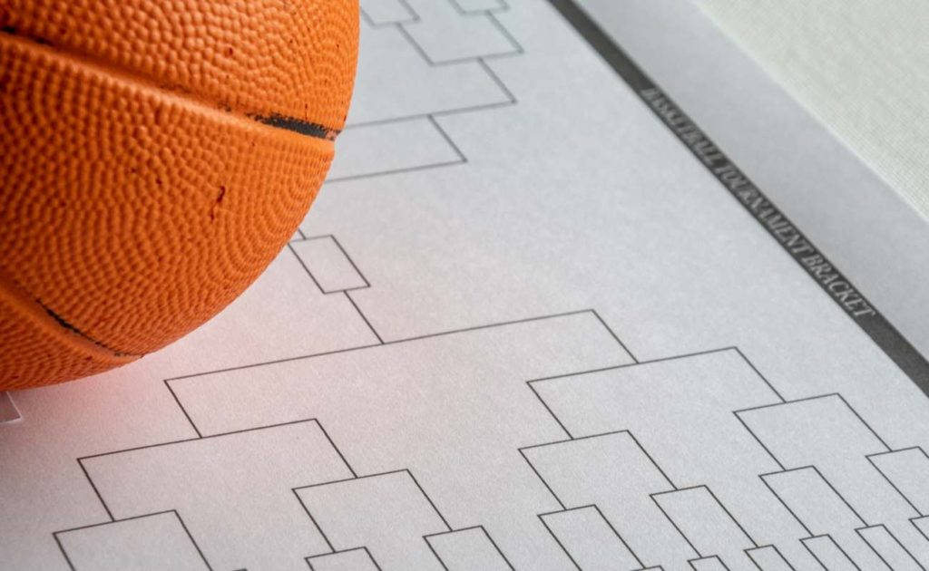 Blank bracket grid on white paper with basketball on top