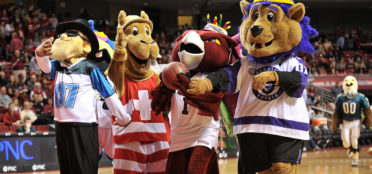 Hooter the Temple mascot celebrates his birthday during basketball game