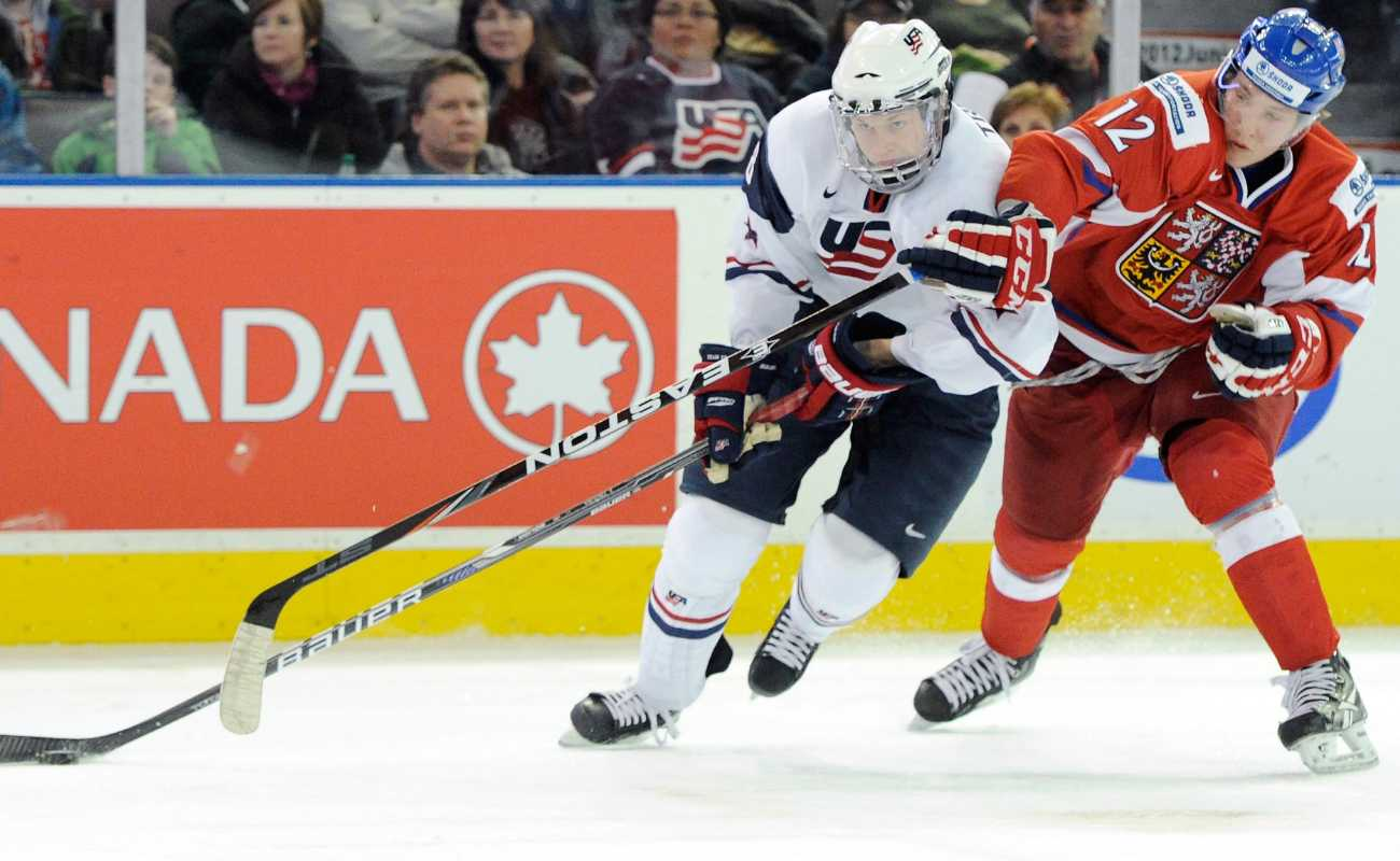 Jacob Trouba #8 of Team USA skates while being defended by Daniel Krejci #12 of Team Czech Republic during 2012 World Junior Hockey Championship