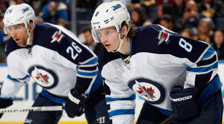 Jacob Trouba #8 and Blake Wheeler #26 of the Winnipeg Jets prepare for a face-off against the Buffalo Sabres on December 17, 2013