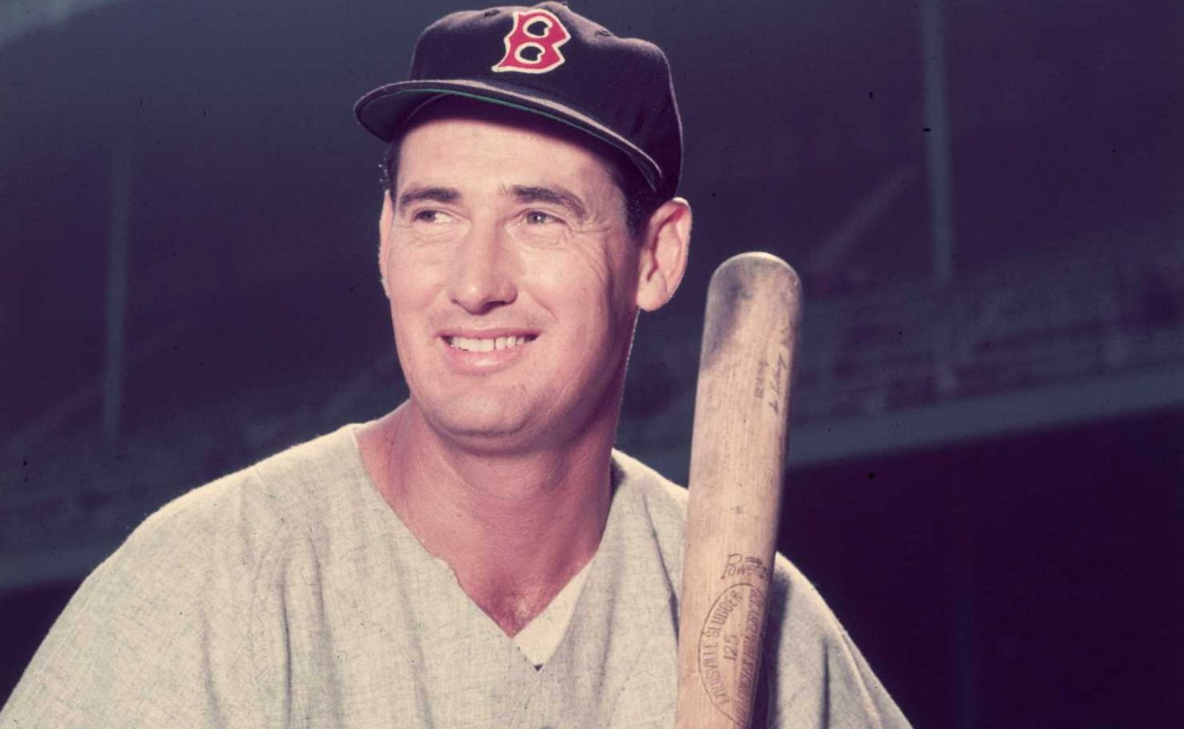 Baseball legend Ted Williamsof the Boston Red Sox holding a bat circa 1955