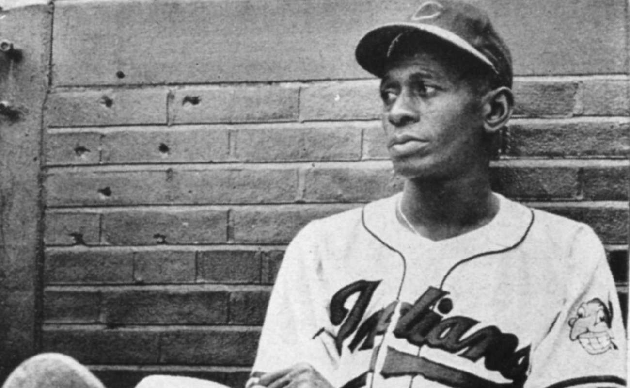 Satchel Paige resting against wall at Metropolitan Stadium in Cleveland in 1948