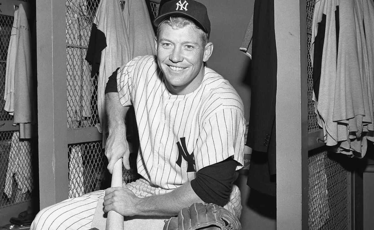 """Mickey Mantle #7 of the New York Yankees """"bones"""" a bat prior to a game in 1956 at Yankee Stadium"""