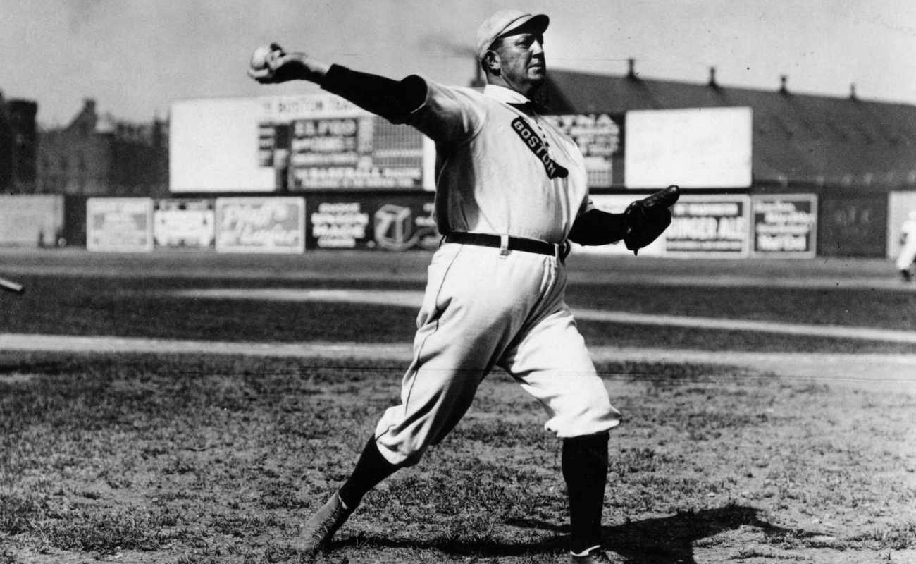 Cy Young of the Boston Red Sox warming up before game in Boston in 1908