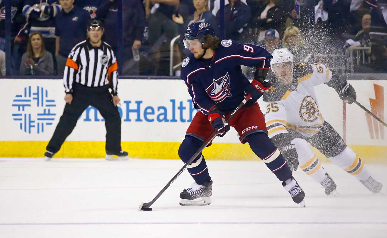 Artemi Panarin #9 of the Columbus Blue Jackets controls the puck while playing against the Boston Bruins
