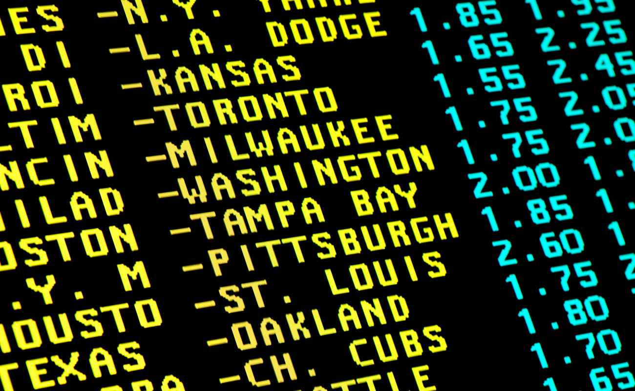 Sight on the monitor with teletext and betting offer of baseball matchups.