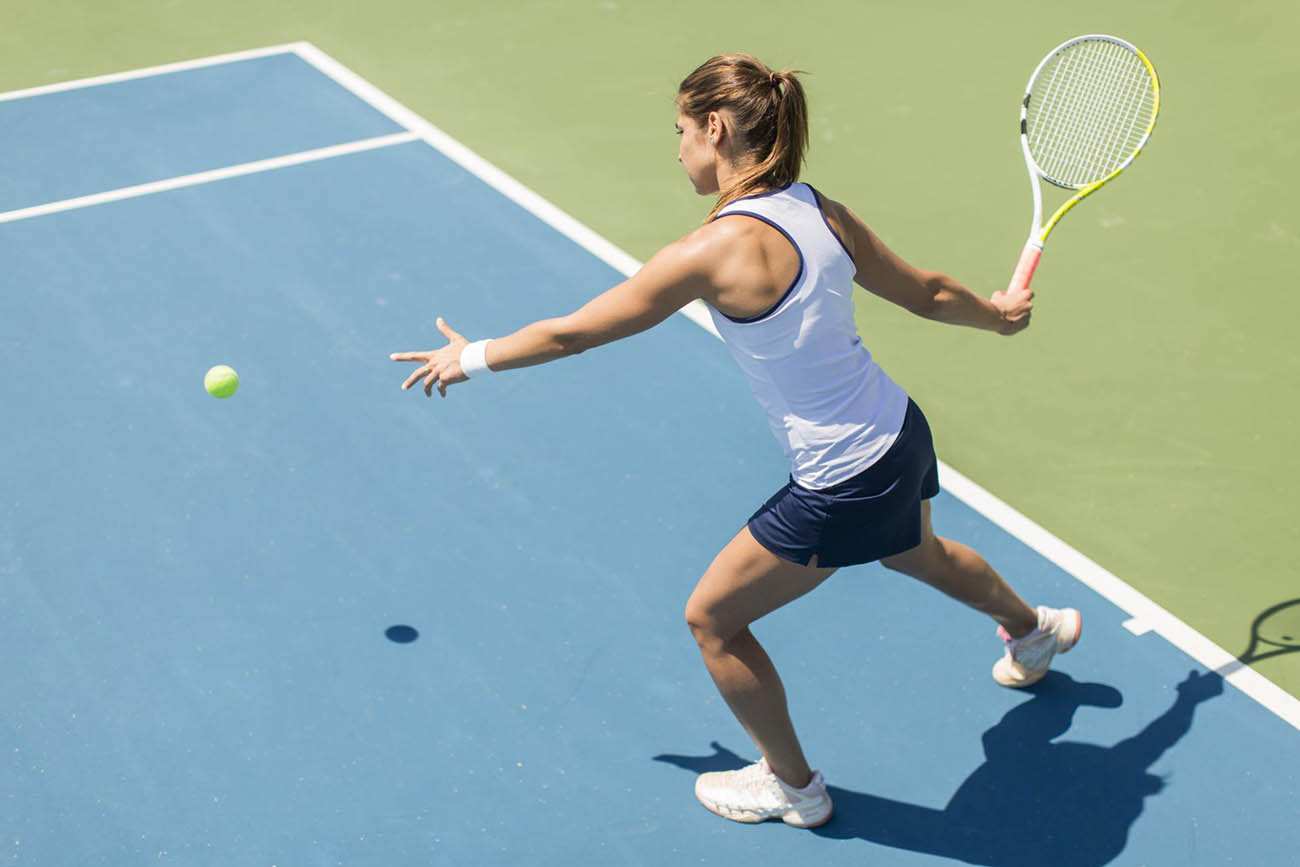 female tennis player getting ready to return a serve