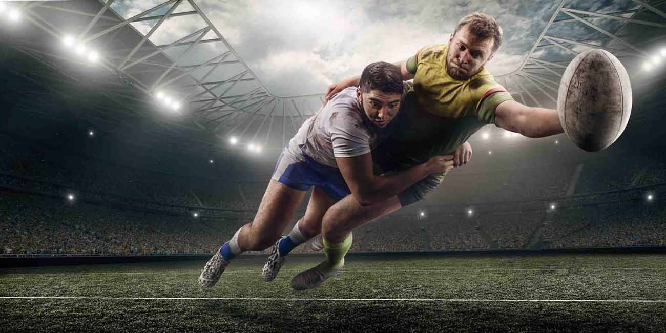 rugby player reaching for the tryline with a tackler holding onto him