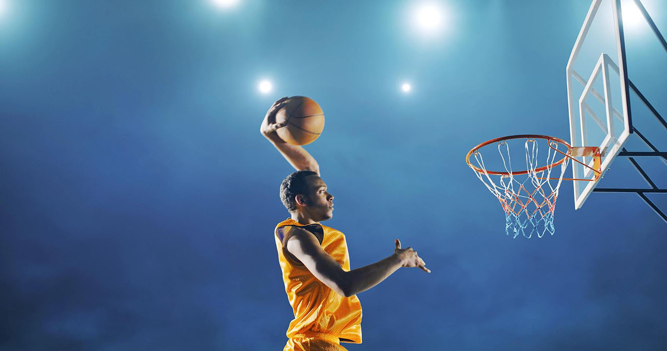 basketball player getting ready to slam dunk