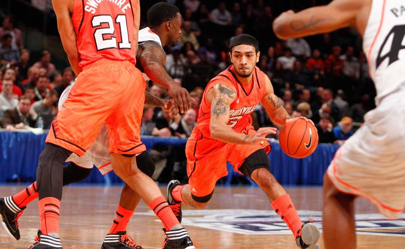 University of Louisville guard Peyton Siva dribbling basketball