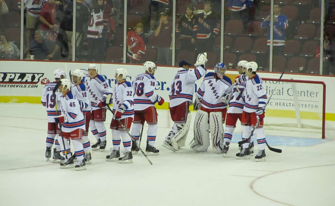 The New York Rangers celebrate a victory over the New Jersey Devils