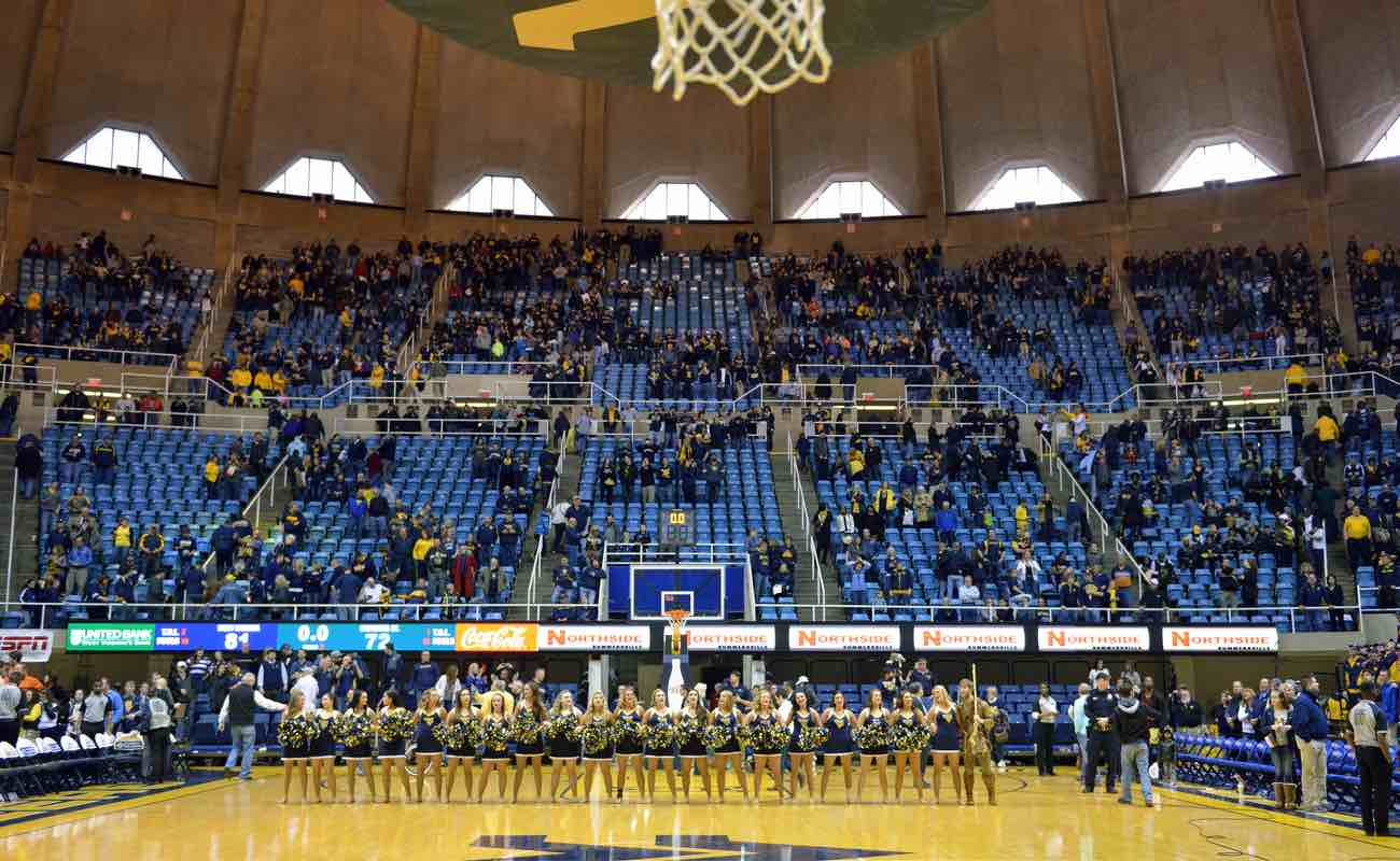 The WVU dance team lines up on the court in full stadium