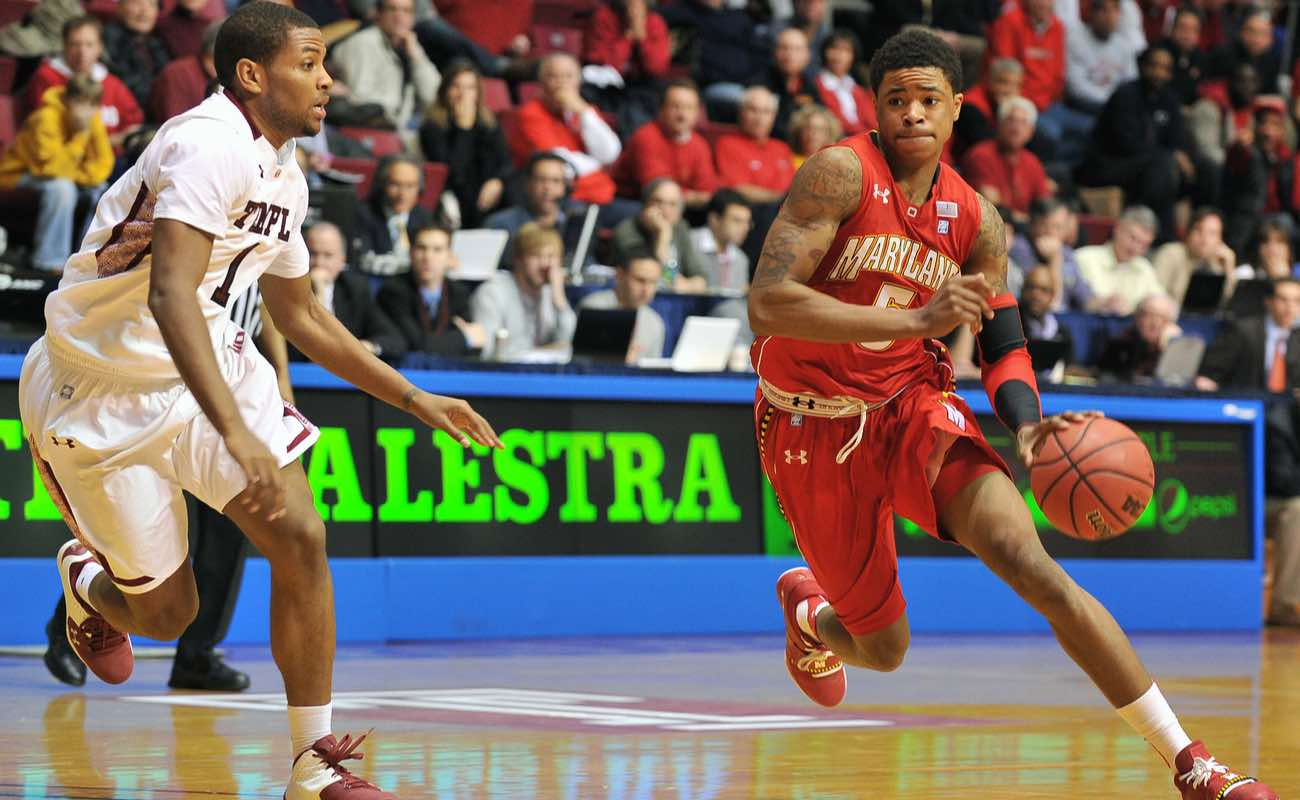 Maryland guard Nick Faust dribbling basketball