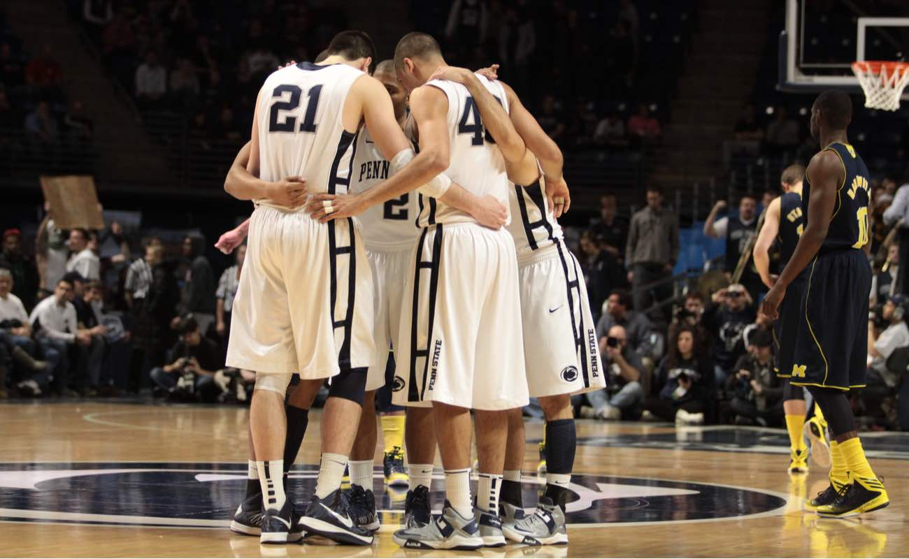 Penn State's players gather at mid-court before a basketball game