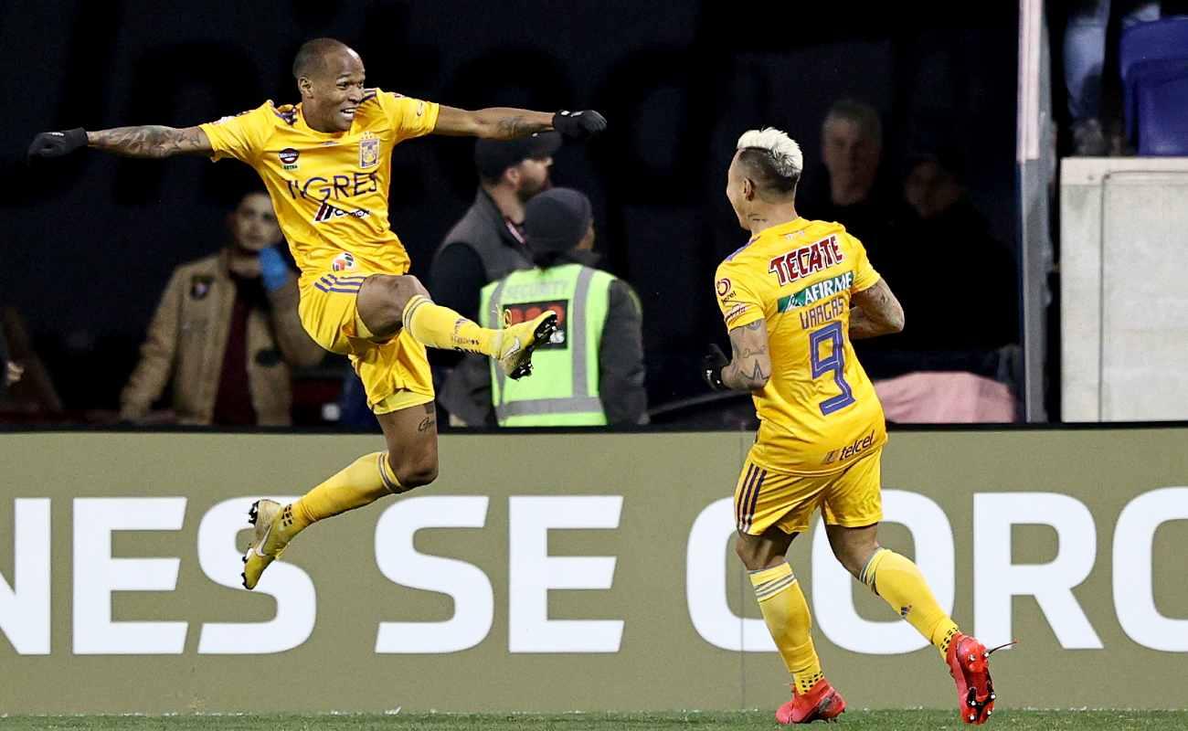 Eduardo Vargas of UANL Tigres celebrates his goal with teammate Luis Quinones against the New York City FC