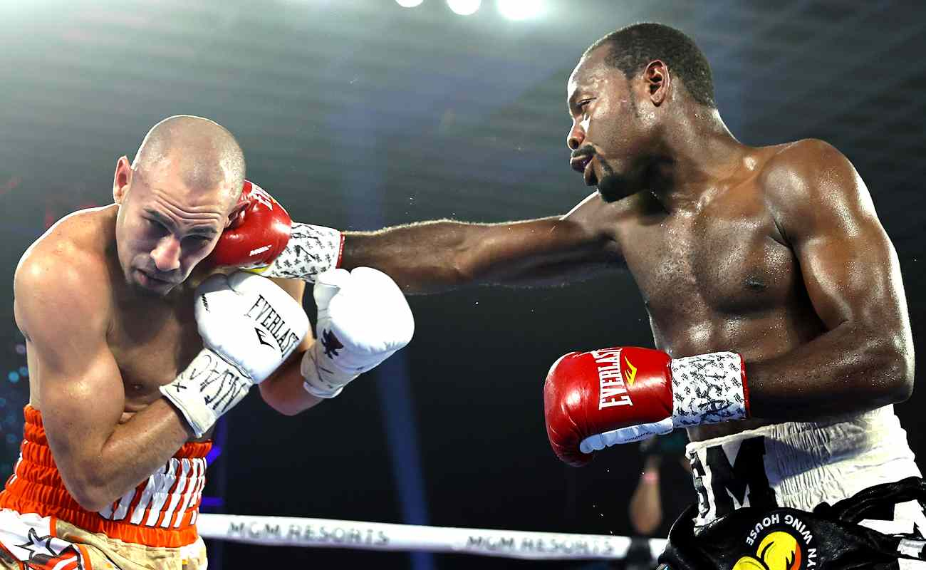 Junior welterweight boxer Jose Pedraza is punched by Mikkel LesPierre in the boxing ring.