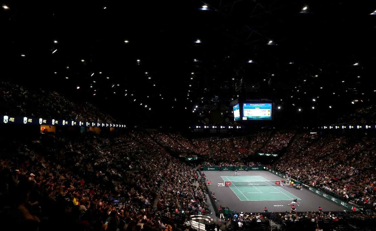 A view from the top stands of Novak Djokavic playing tennis against Denis Shapovalov in the Rolex Paris Masters