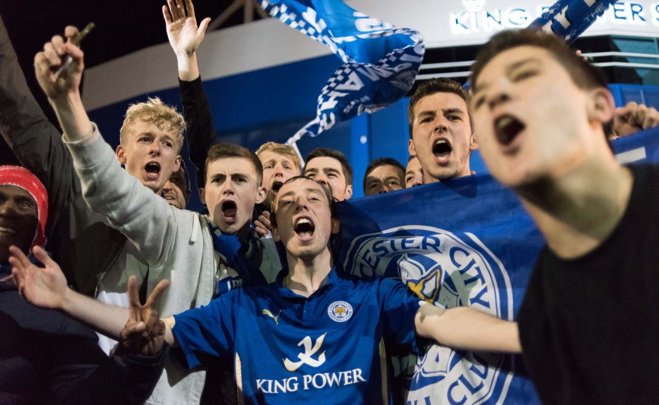 Leicester city fans out on the streets celebrating the premier league title