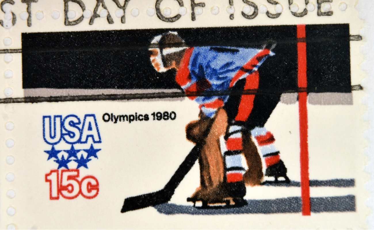 stamp printed in the USA dedicated to the 13th Winter Olympic Games in1980 featuring an ice hockey player
