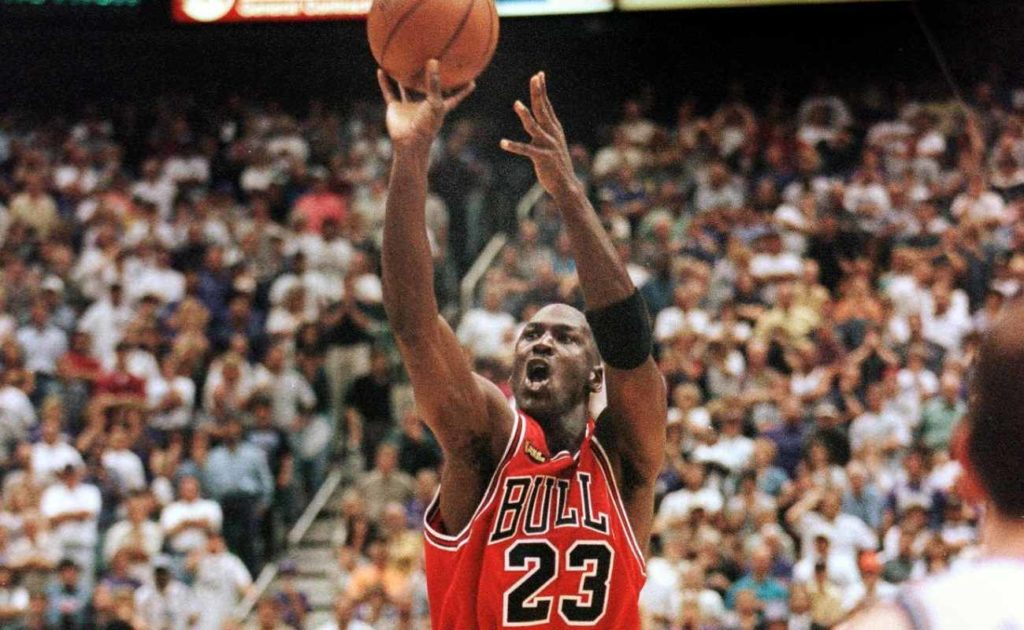 Michael Jordan of Chicago Bulls aims and shoots the game-winning jump shot at NBA Finals