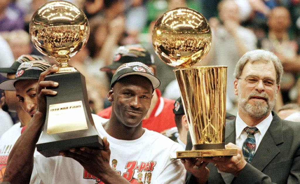 Michael Jordan and Chicago Bulls head coach Phil Jackson holding Most Valuable Player trophy