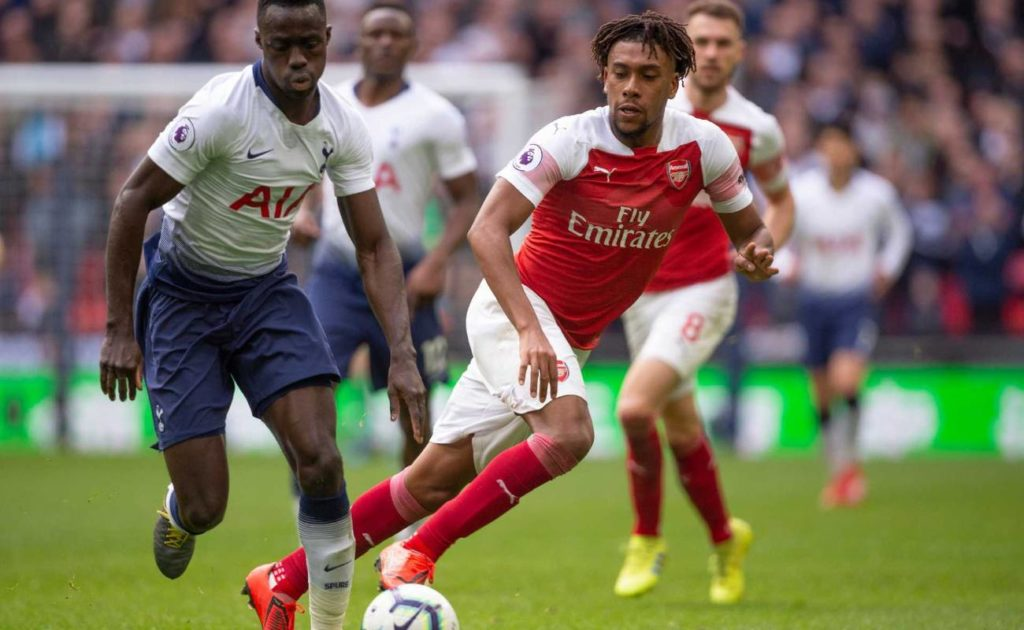 Davinson Sánchez of Tottenham Hotspur and Alex Iwobi of Arsenal during the Premier League
