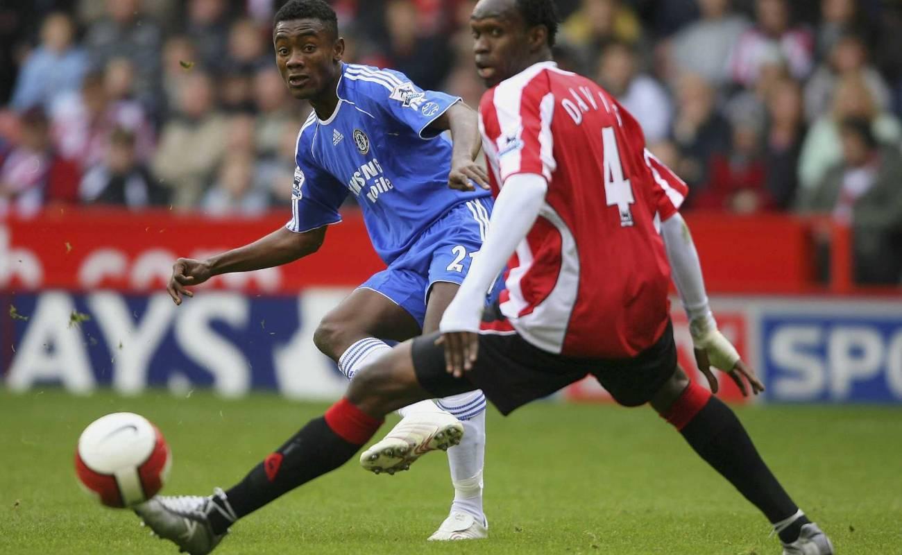 Chelsea striker Salomon Kalou gets in a shot past Sheff United defender Claude Davis during Barclays Premier League match